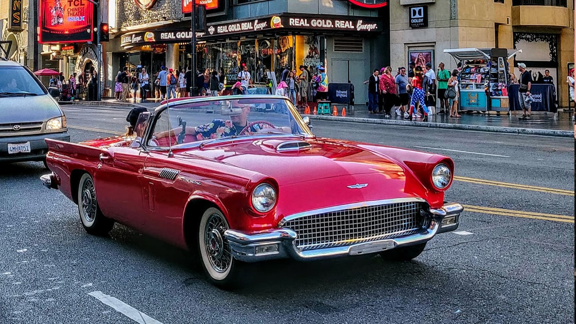 red ford thunderbird driving though santa monica