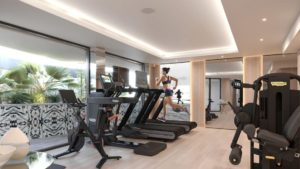 woman running on treadmill at the hotel gym